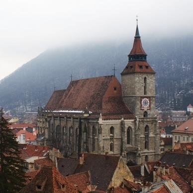 A photograph of the city of Brasov on a misty day, taken by a volunteer in Europe.